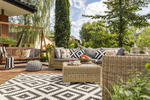 New design villa patio with comfortable rattan furniture and pattern carpet